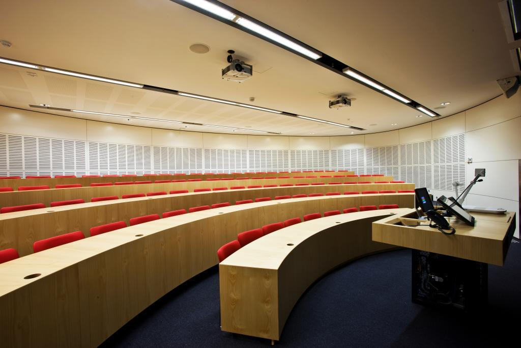SUPACOUSTIC slotted acoustic panel wall in a lecture theatre at Faculty of Law, University of Sydney